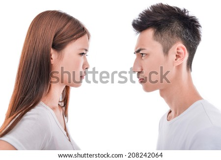 Closeup profile image of happy young couple looking face to face at each other - stock photo
