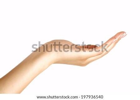 Closeup profile of beautiful female hand offering on white