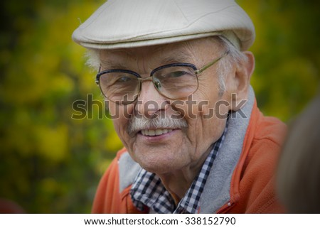 Closeup Profile on a Smiling Old Man With a Grey Beard