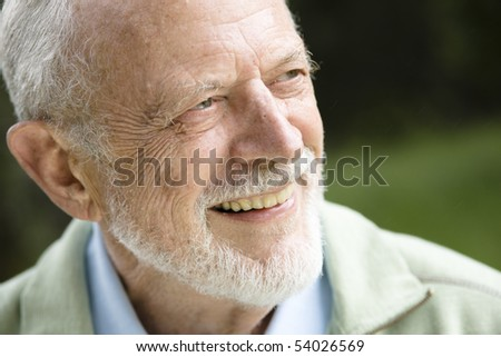 Closeup Profile on a Smiling Old Man With a Grey Beard - stock photo