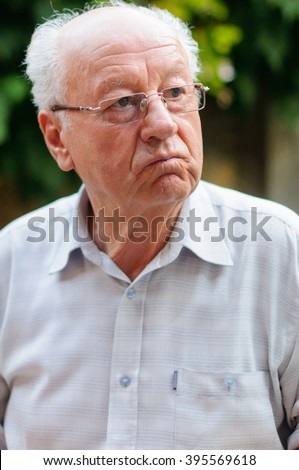 Closeup profile on a tired old man - stock photo