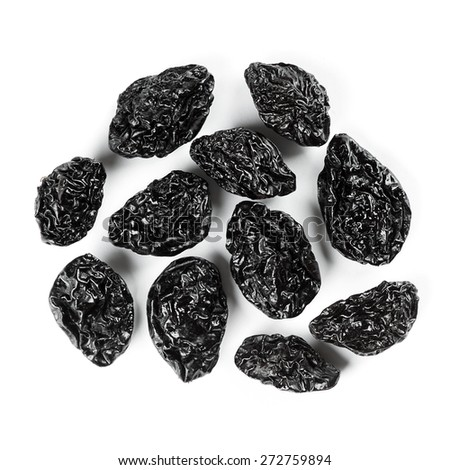 Closeup prunes on white background - stock photo