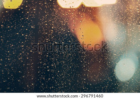 closeup  raindrops on the window. vintage picture - stock photo