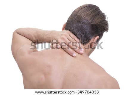 Closeup rear upper back view of shirtless Caucasian man rubbing painful sore neck on white background - stock photo