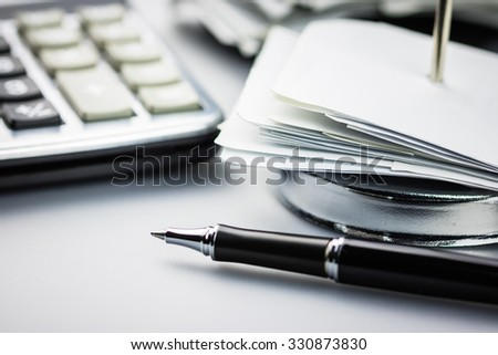 Closeup receipts in paper nail on financial desk - stock photo