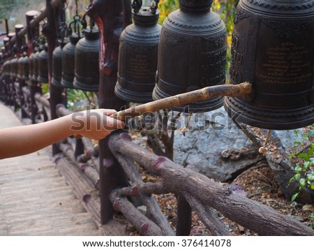 Closeup ringing a bell in a Buddhist temple at doem Bang Nang Buat District, Suphan Buri, Thailand