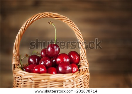 closeup  Ripe Sweet Cherry in the Basket  on Rustic Wooden background