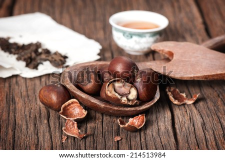 closeup roasted chestnuts on wooden desk  - stock photo