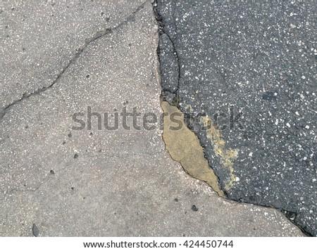 Closeup rough cracked rocky or brick block road - stock photo