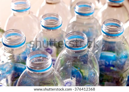 Closeup rows and pack of Plastic water bottles. - stock photo