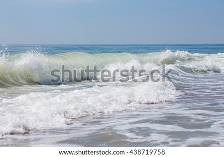 Closeup sea wave with the white foam and drops