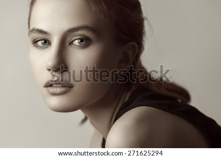 Closeup sensual beauty portrait of young red-haired model. . Professional nude makeup. - stock photo