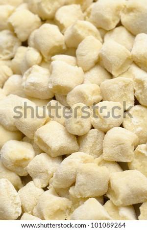 closeup shoot of a group of handmade gnocchi - stock photo