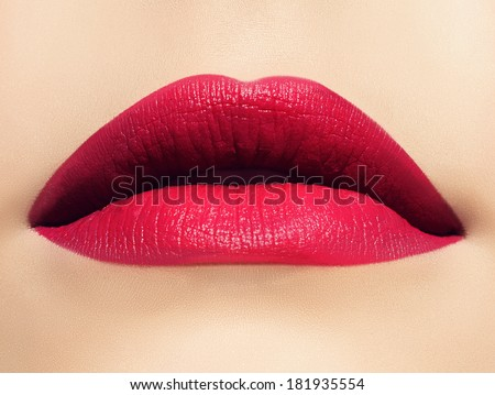 Closeup shoot of beautiful lips of woman with pink matt lipstick. Close-up of beautiful full lips - stock photo