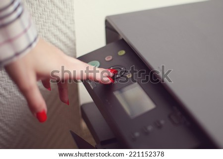 Closeup shoot of female hand working with photocopier - stock photo