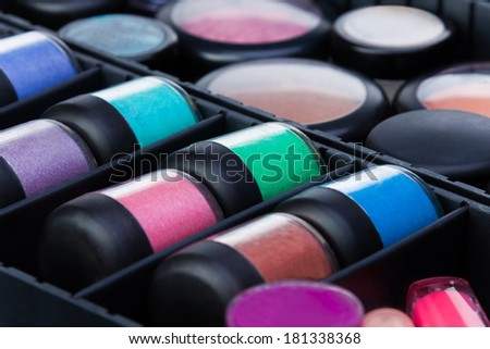 Closeup shoot of many color jars in makeup beautician case - stock photo