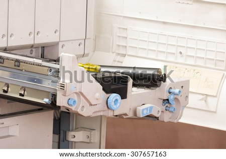 closeup shot digital photocopier machine with open tray compartment