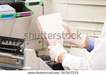 closeup shot hans changing toner cartridge in digital photocopier machine