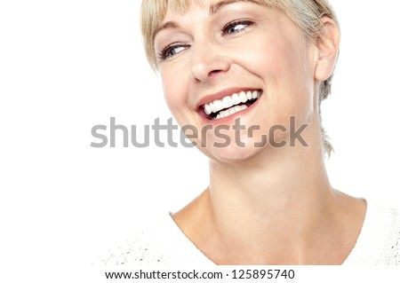Closeup shot of a beautiful woman smiling heartily, cropped image. - stock photo
