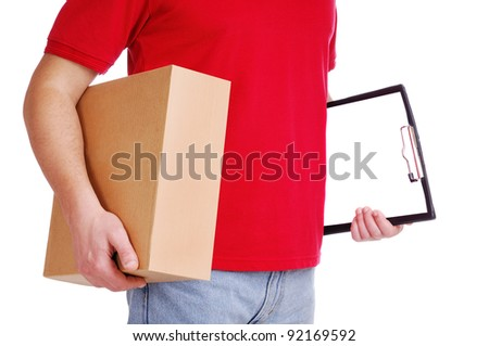 Closeup shot of a courier holding the box and the tablet - stock photo