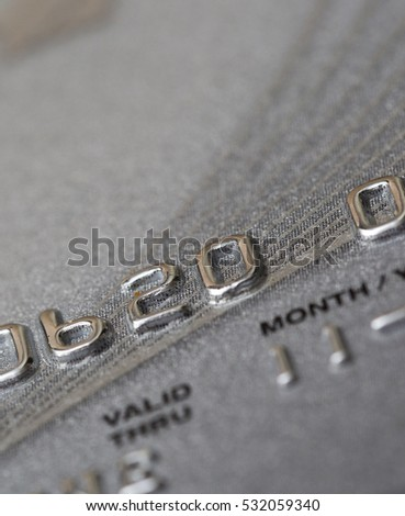 Closeup shot of a credit card. Numbers are partly shown. Validity partly visible.