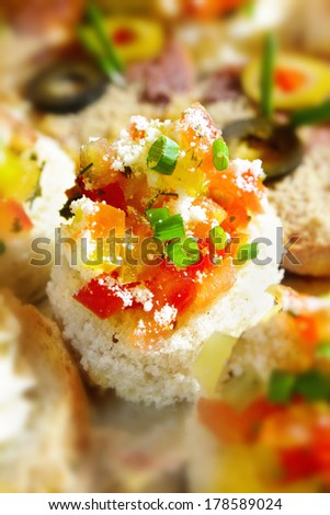 Closeup shot of a fresh canapes on party platter. Catering concept with finger food - stock photo