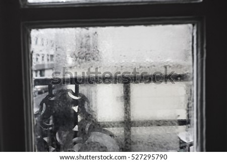 Closeup shot of a steamy window with water drops made in dull day
