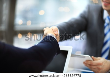 Closeup shot of a two businesspeople shaking hands - stock photo