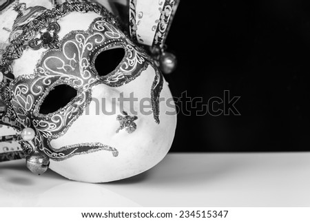 Closeup shot of a venetian mask edited in black and white