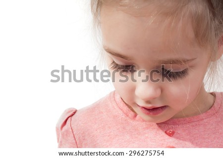 Closeup shot of beautiful little girl with long eyelashes - stock photo