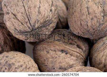 Closeup shot of bunch of wallnuts in their shells - stock photo