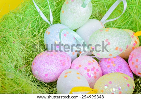 Closeup shot of easter eggs in green nest  - stock photo