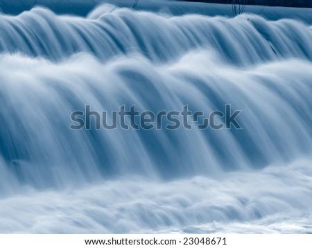 closeup shot of falling water, toned image - stock photo