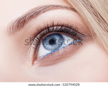Closeup shot of female eye  with day makeup with Snorkel Blue colour liner looking up