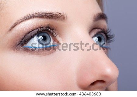 Closeup shot of female eyes  with day makeup with Snorkel Blue colour liner