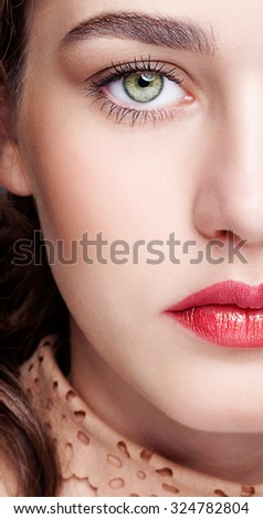Closeup shot of female face with day makeup and  green pistachio colour eyes - stock photo