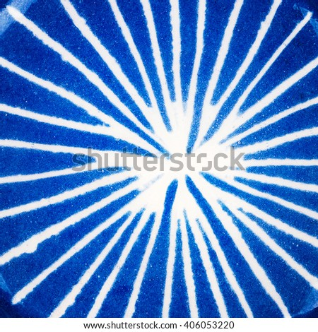 Closeup shot of glazed lined blue ceramics texture - stock photo