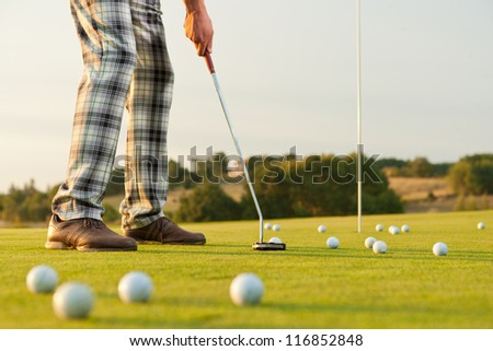 closeup shot of golfer  with golf club during practice