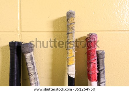 Closeup shot of hockey sticks - stock photo
