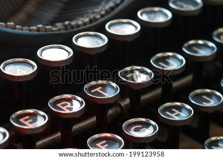 Closeup shot of keys on an antique typewriter. Shallow DOF. - stock photo