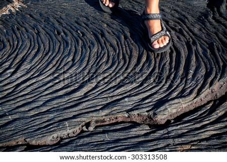 Closeup shot of lava formations in Santiago Island, Galapagos, Ecuador - stock photo