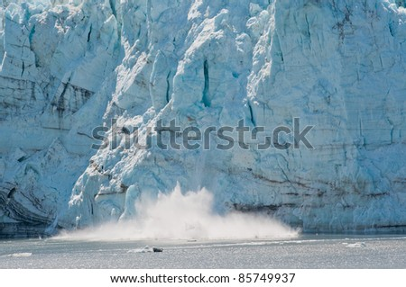 Closeup shot of majestic calving of Margerie Glacier.