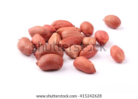Closeup shot of peanut kernels isolated on white background. - stock photo