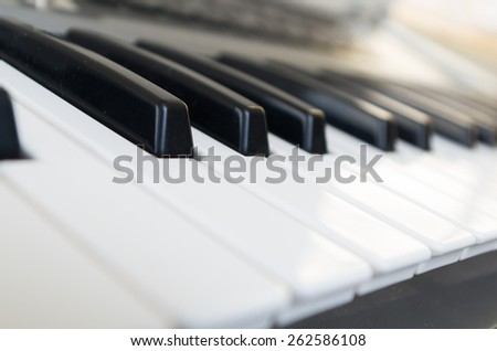 closeup shot of piano selective focus side view - stock photo