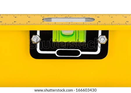 Closeup shot of spirit level for construction work isolated on white background - stock photo