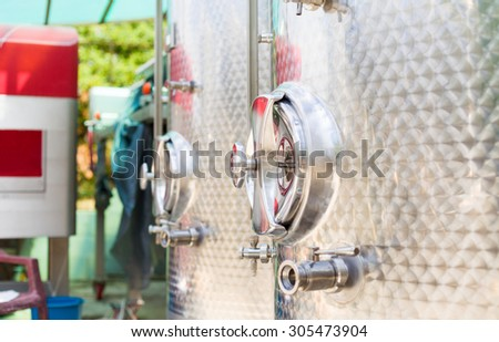 Closeup shot of the door of a fermentation tank for wine. - stock photo