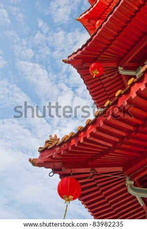 Closeup shot of traditional Oriental Chinese architectural details against beautiful sky. - stock photo