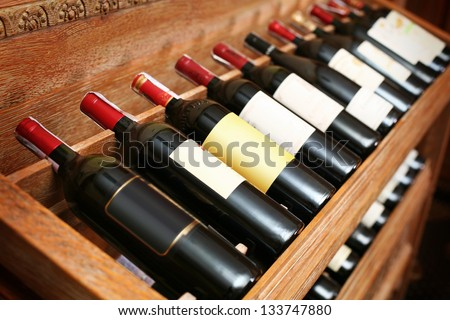 Closeup shot of wineshelf. - stock photo