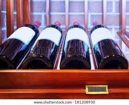 Closeup shot of wineshelf - stock photo