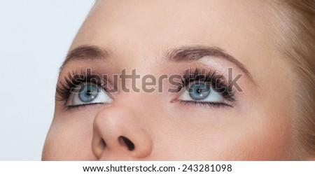Closeup shot of woman blue eyes with makeup - stock photo
